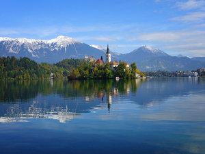 CALVENDO Puzzle Reflexion der Kirche und der Berge im Bleder See
