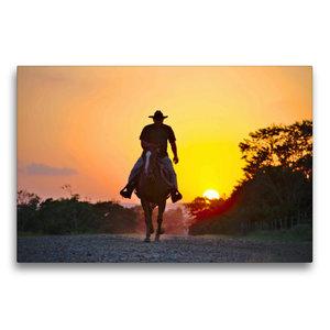 Premium Textil-Leinwand 75 cm x 50 cm quer Ein Cowboy reitet in